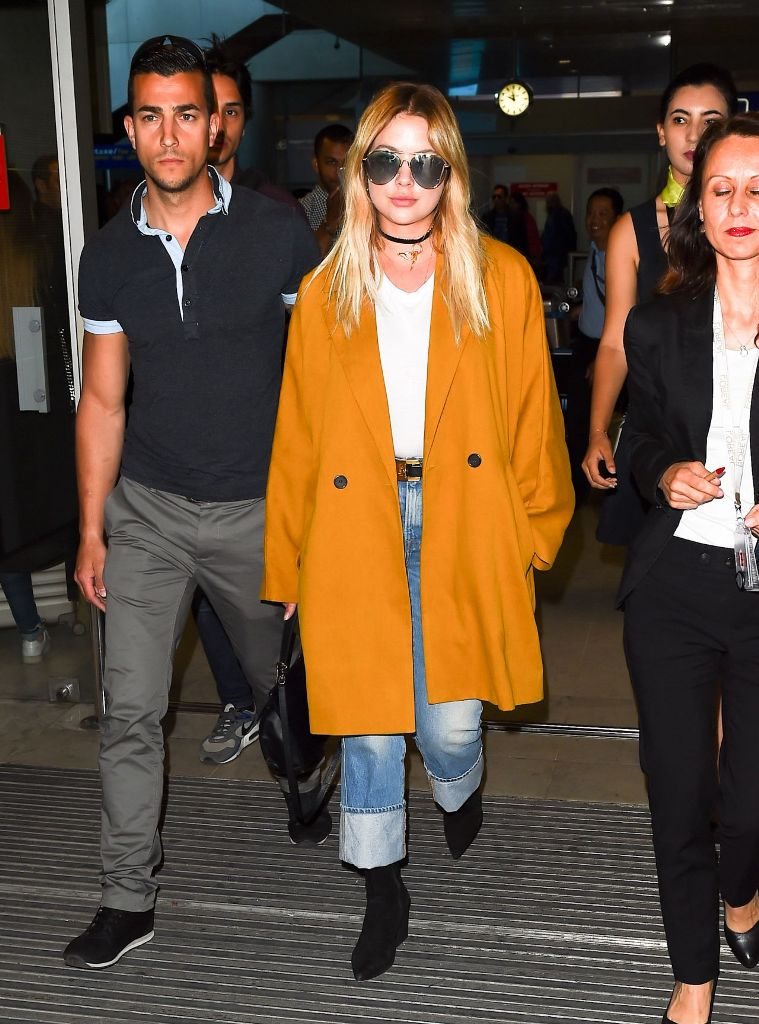 Ashley Benson travel outfit arriving at Nice airport for 70th Cannes Film Festival