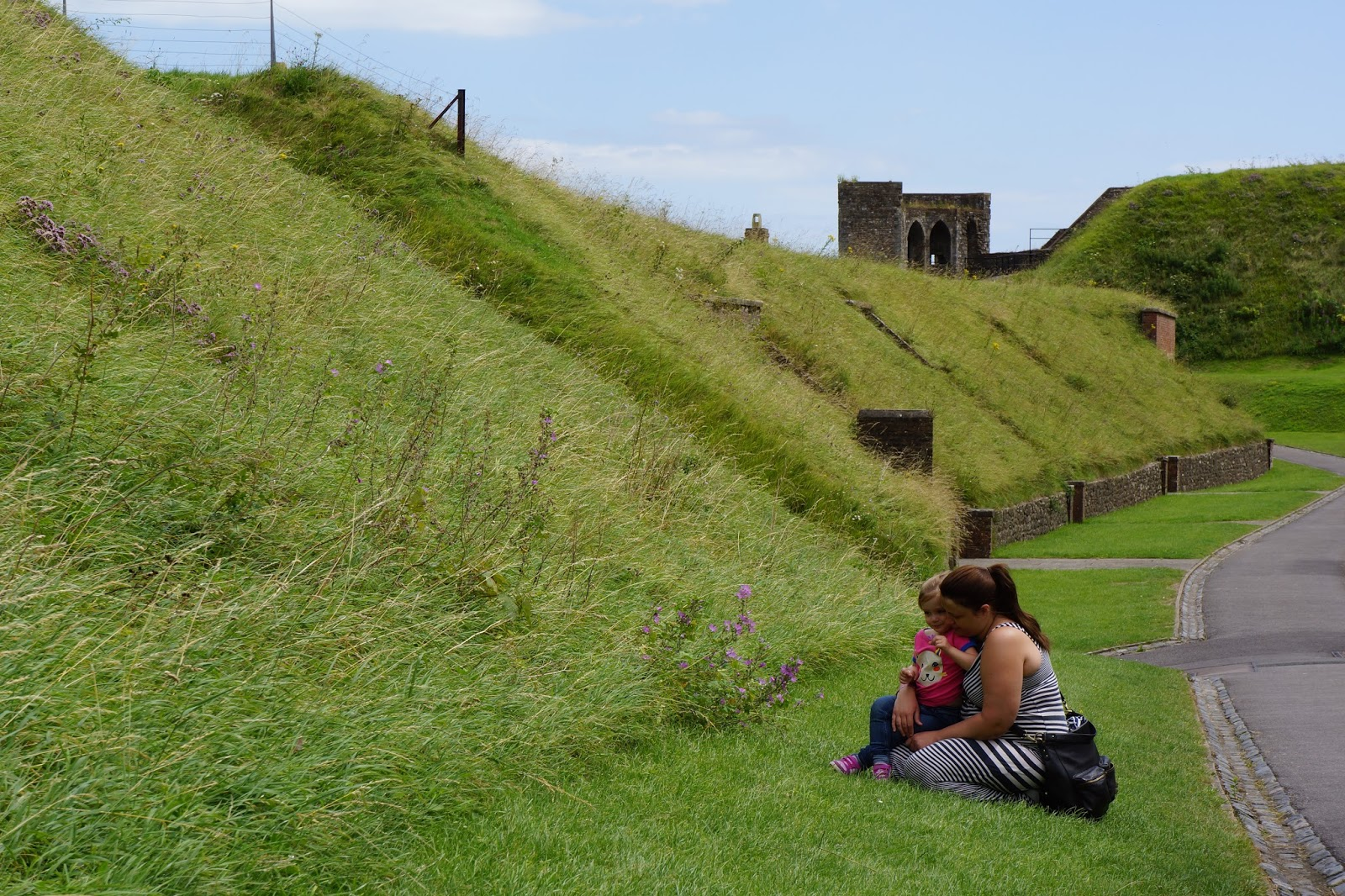 mum and daughter near a moat at dover castle