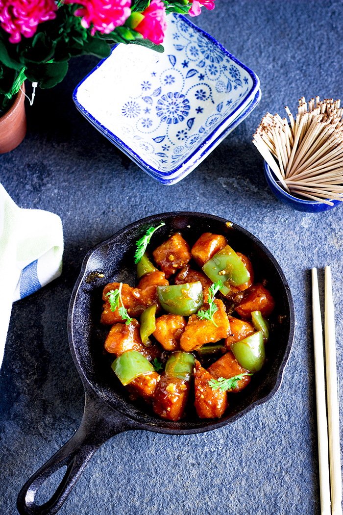 Batter fried tofu in a spicy chinese sauce with green capsicum