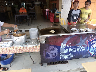Roti making station infront of the shop