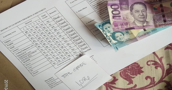 Parents give reward of money equivalent to son's total grades