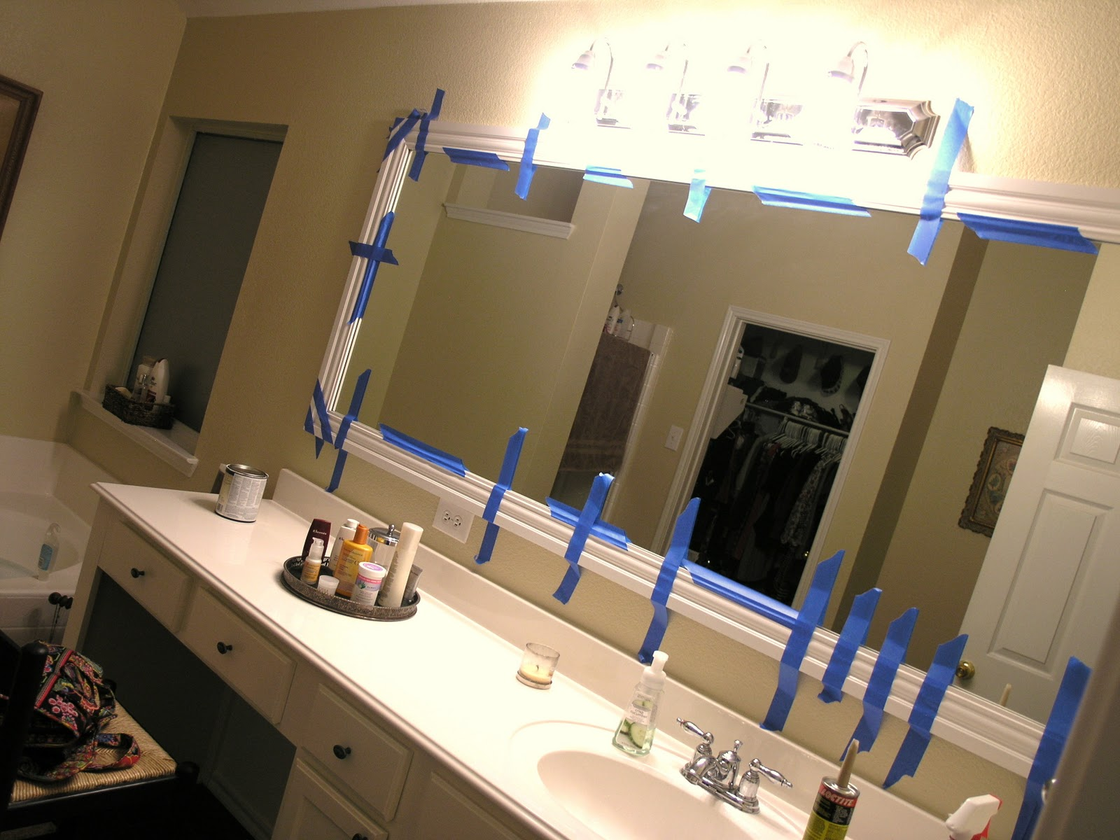 bathroom baseboard ideas it s a wannabe decorator s framing out a mirror and 10276
