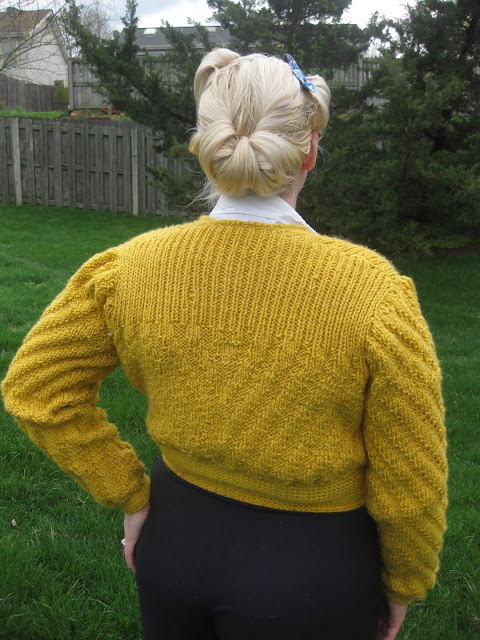 1940s date maker knitted cardigan and victory roll updo