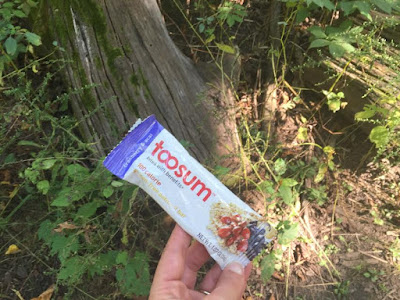 Toosum Cranberry and Acai Gluten Free Oatmeal Bar on a hike