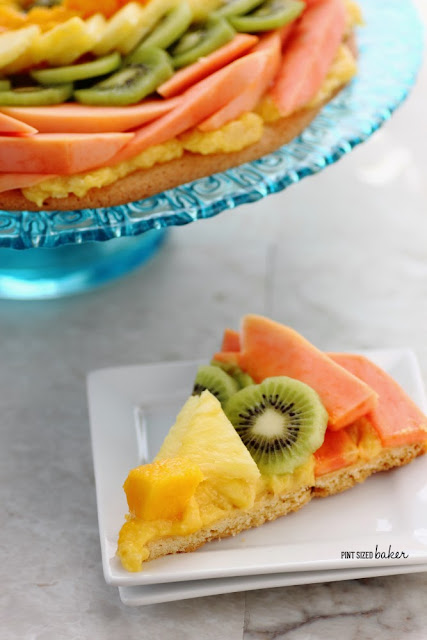 I love tropical fruit and this pizza dessert has it all! Papaya, pineapple, and mango on a cookie crust.