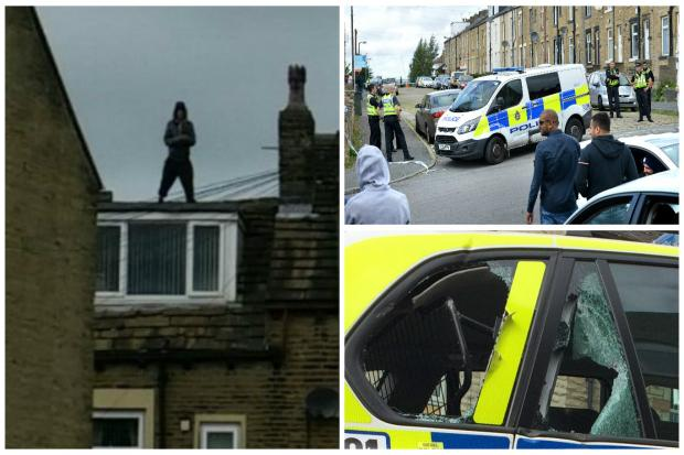 ROOFTOP DRAMA: Man, 28, remains in custody today after 11-hour stand-off with police