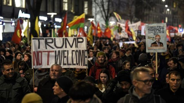 "Protests have erupted in Switzerland ahead of Trump's Davos trip: ""Trump Not Welcome."""
