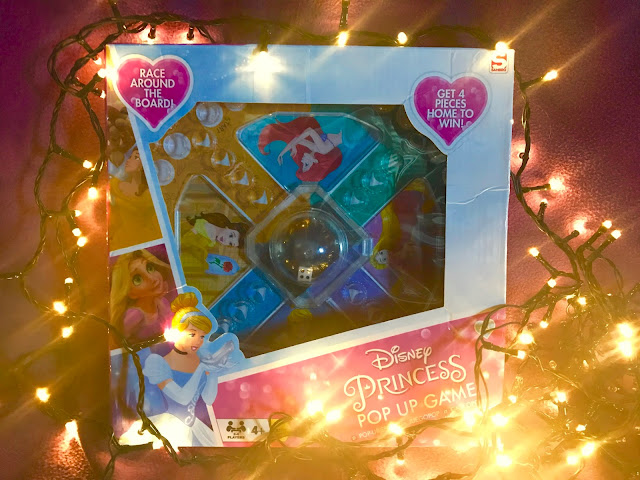 A game with a pop up dice with Disney Princess theming surrounded by (yes you guessed it) fairy lights!