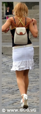 Girl in white skirt on the street