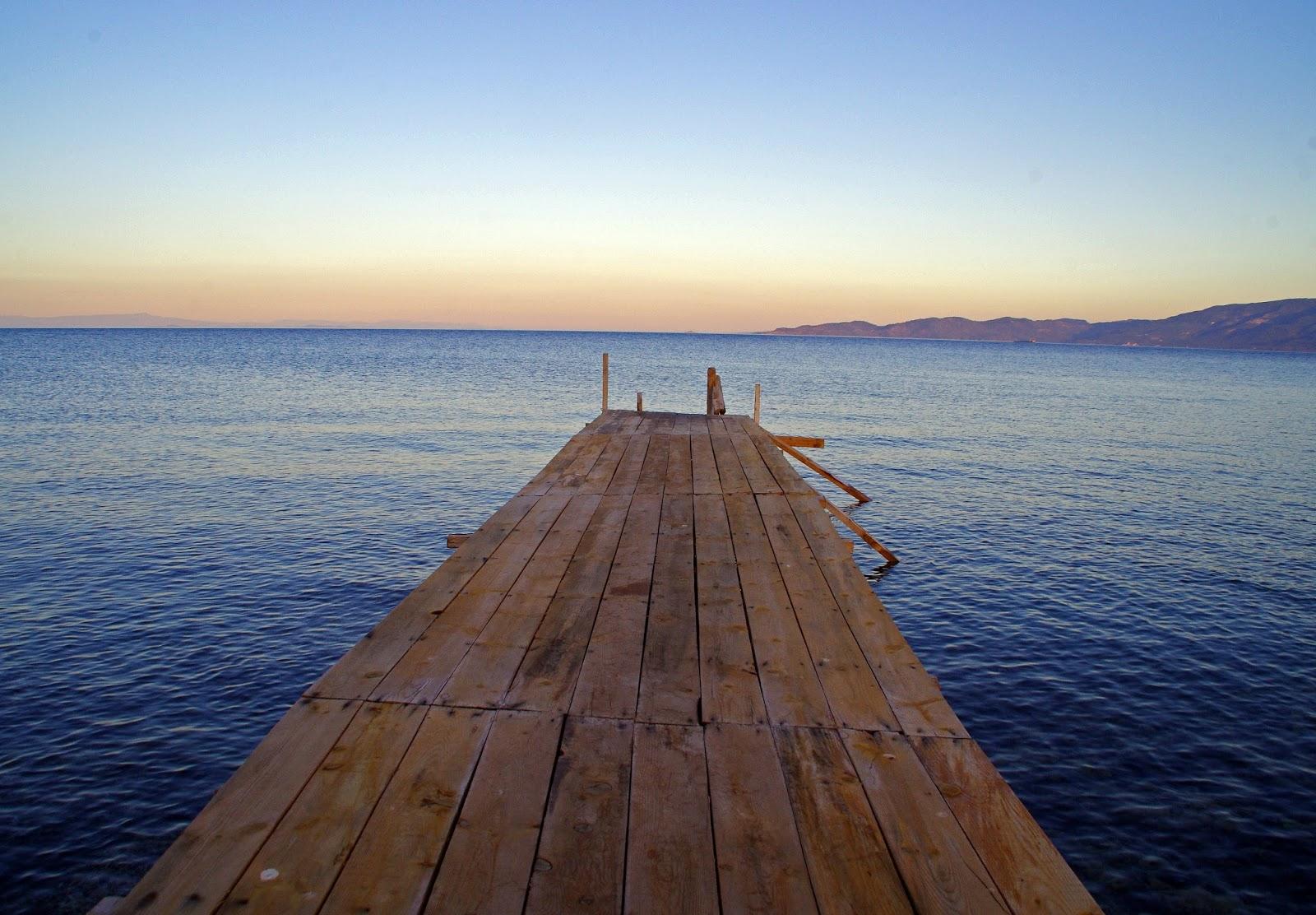 Beautiful sunset over Pier in Assos Turkey