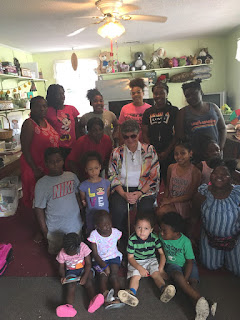 Laurel with Rev. Christian King and day campers at the Pink House Neighborhood Resource Center
