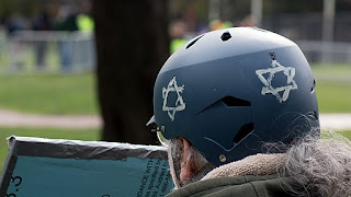 Person at antifascist rally wearing helmet with Star of David painted on it