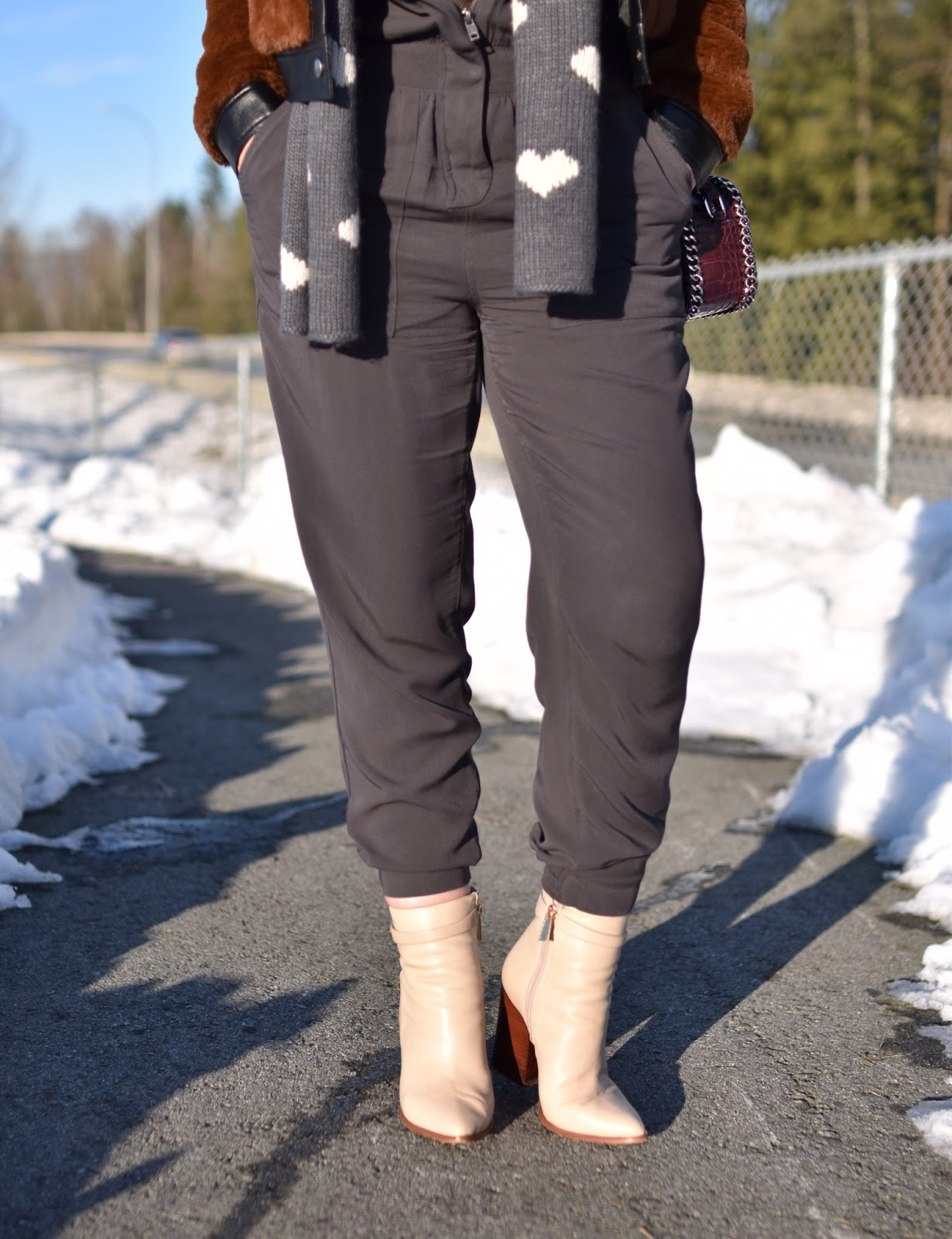 Monika Faulkner outfit inspiration - jumpsuit, teddybear bomber jacket, ivory Vince Camuto booties