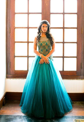 Love this turquoise color wedding gown. It is simply perfect.