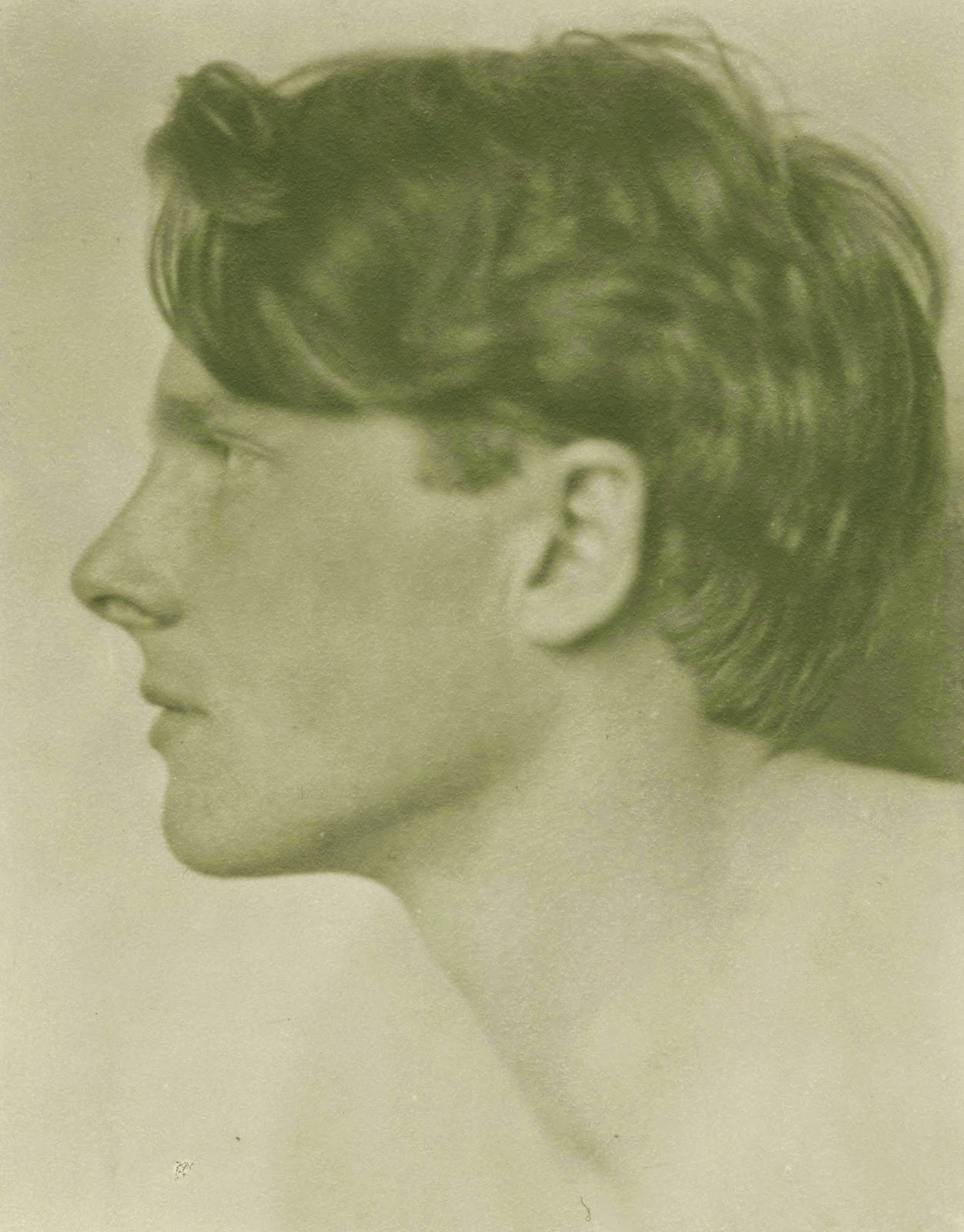 A photograph in profile of Rupert Brooke.