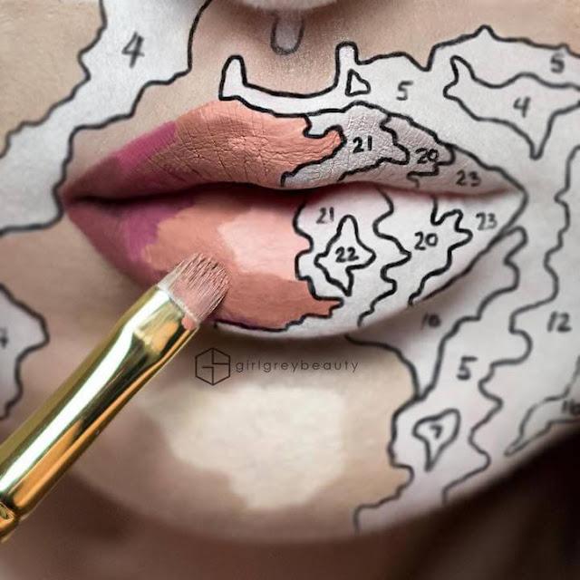 Artista usa seus lábios como uma tela para criação de obras de arte
