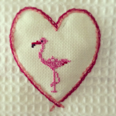 flamingo with cross stitch