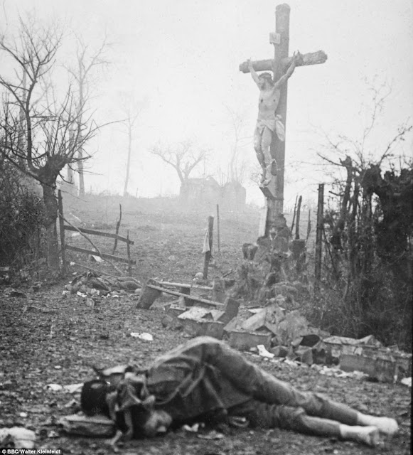 Carnage: Amid the appalling devastation and bodies of dead soldiers, a crucifix stands tall