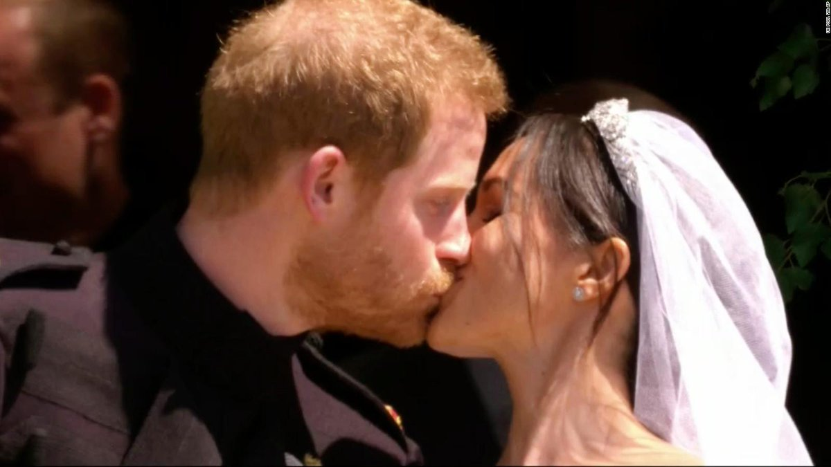 Prince Harry and Meghan, Duchess of Sussex, have shared their first kiss as a married couple