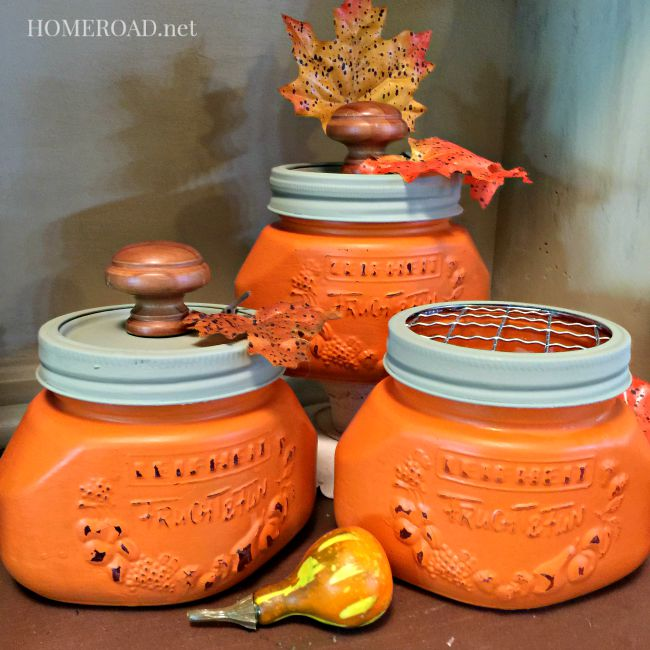 Orange painted mason jars with knob lids