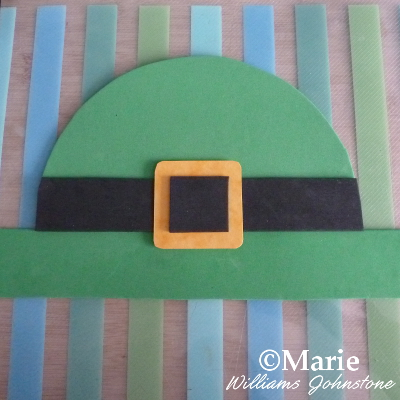green hat and black buckle made from paper
