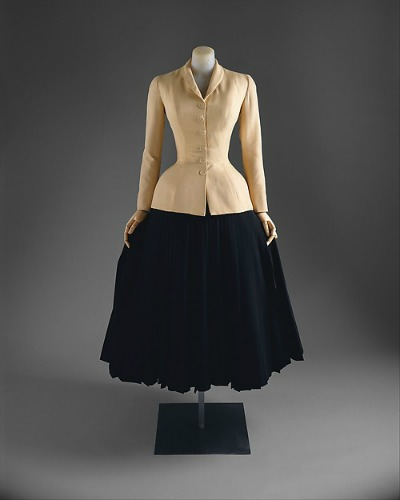 Black skirt, tan jacket on display on dress form for Dior New Look 1947