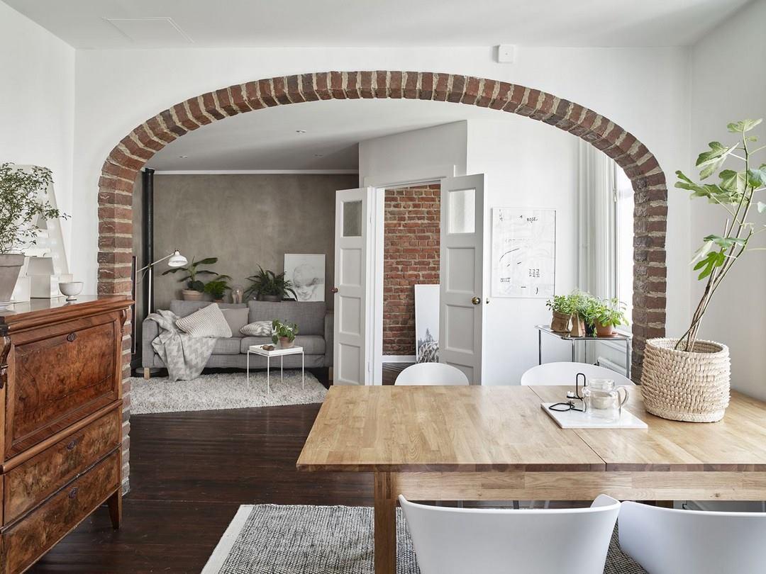 Cărămidă expusă și stil nordic într-un apartament de 80 m²
