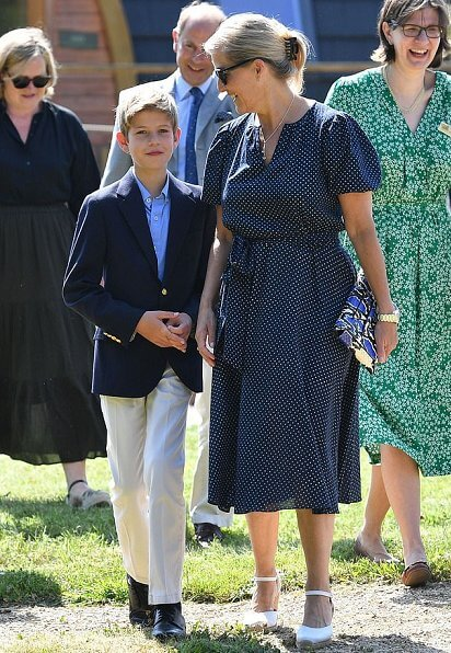 The Countess of Wessex wore a polka dot printed dress by ARoss Girl. ames Viscount Severn and Lady Louise Windsor