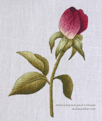 Increased contrast between the petals on the thread painted rosebud (designed by Trish Burr)