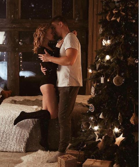 Romantic, sexy, steamy, winter, christmasy photoshoot in bed by Nika Sergah.