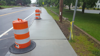 sidewalk gaps along Main St are now filled with concrete