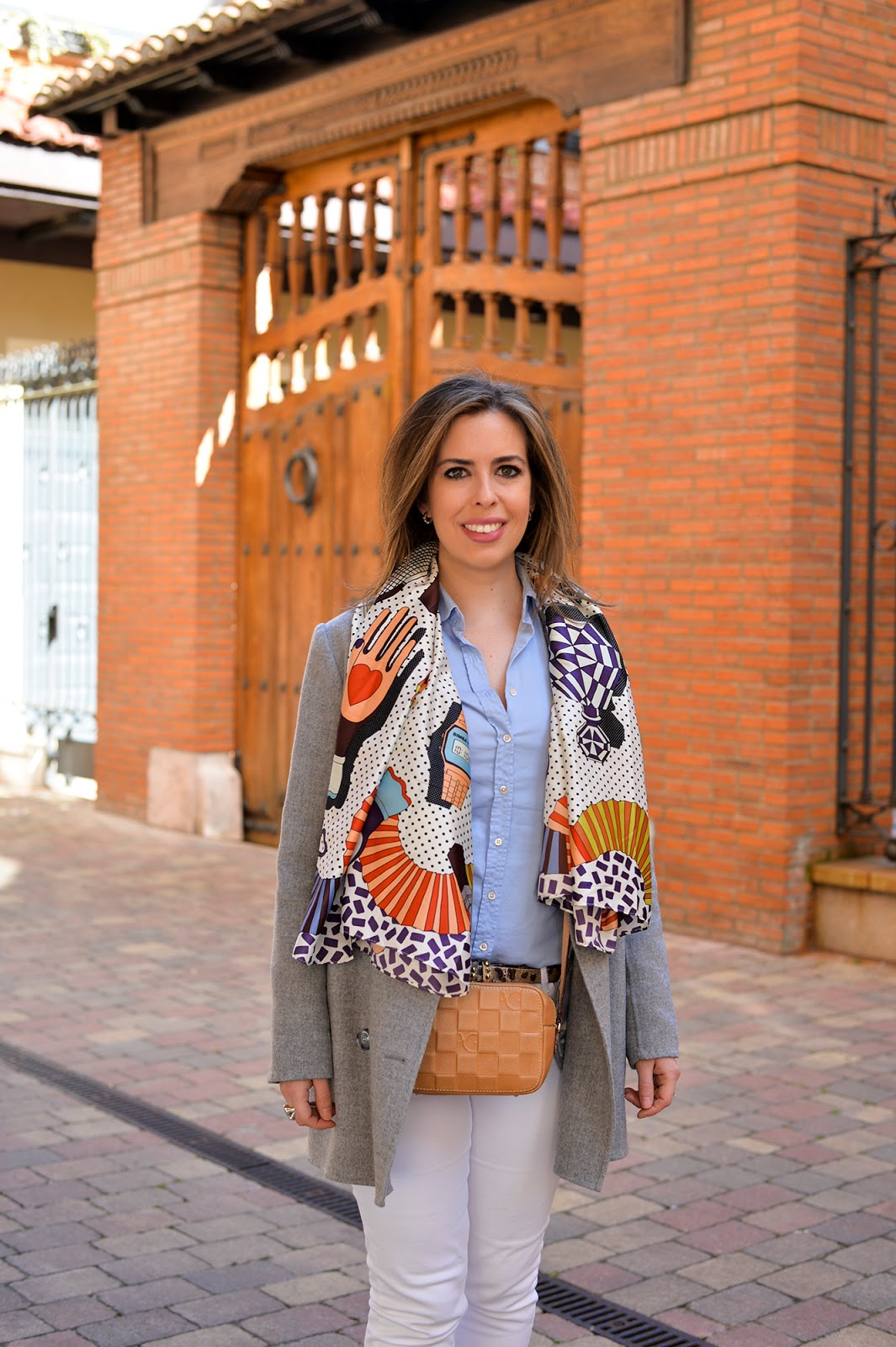 spring travel outfit white jeans gray coat oxford shoes silk scarf crossbody bag europe spain