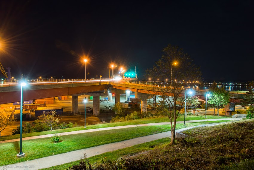 Portland, Maine USA September 2017 photo by Corey Templeton. A nighttime view of the relative peace and quiet of Harbor View Park and the Casco Bay Bridge at night.