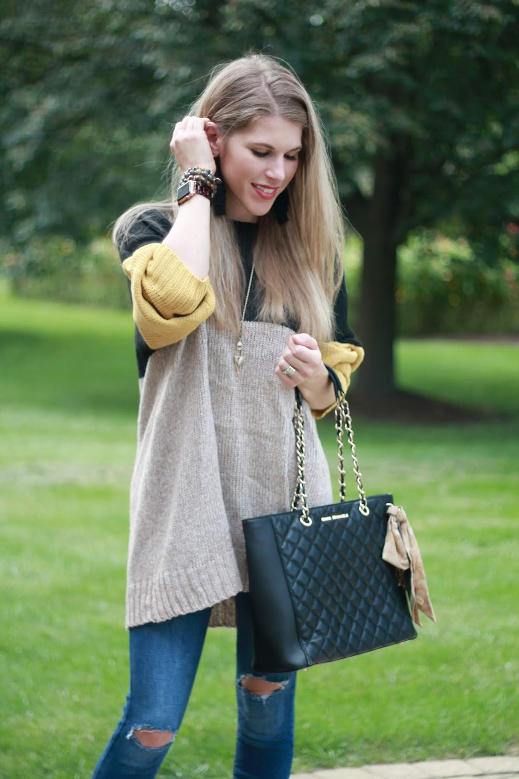 black & yellow colorblock sweater, distressed jeans, peep toe booties, black quilted tote