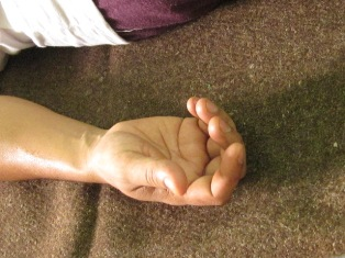 a person's hand in Shava asan or Corpse pose