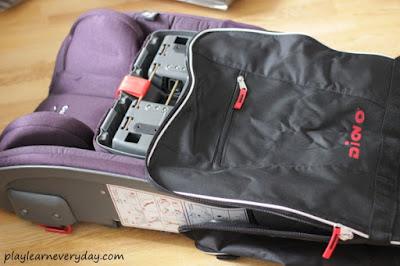 putting the car seat in the travel bag