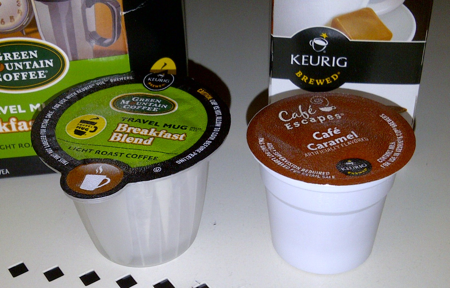 shows a vue pack next to a kcup for size comparision - Keurig Coffee Pods