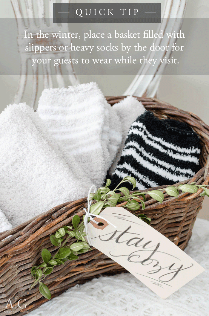 Fill a basket with heavy socks or slippers for your guests to wear while they visit your home.  ||  www.andersonandgrant.com