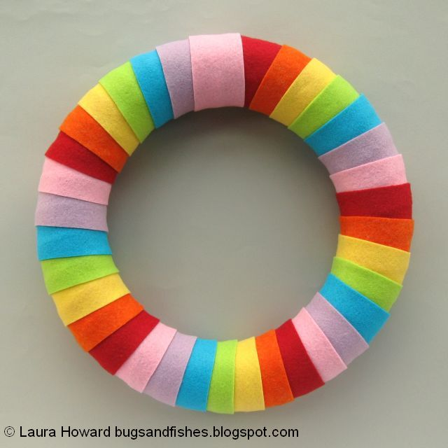 front of the rainbow wreath
