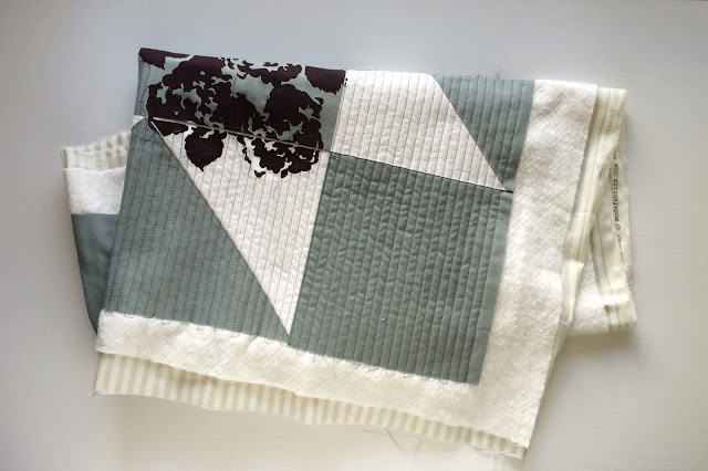 Floral Printed Grey and White Morning Star Modern Quilt with straight-line quilting | Lovely and Enough