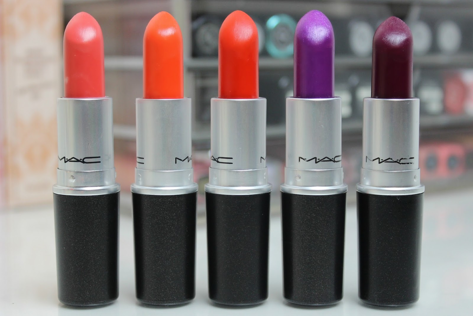 A picture of MAC lipsticks in shades Vegas Volt, Morange, Lady Danger, Violetta and Rebel