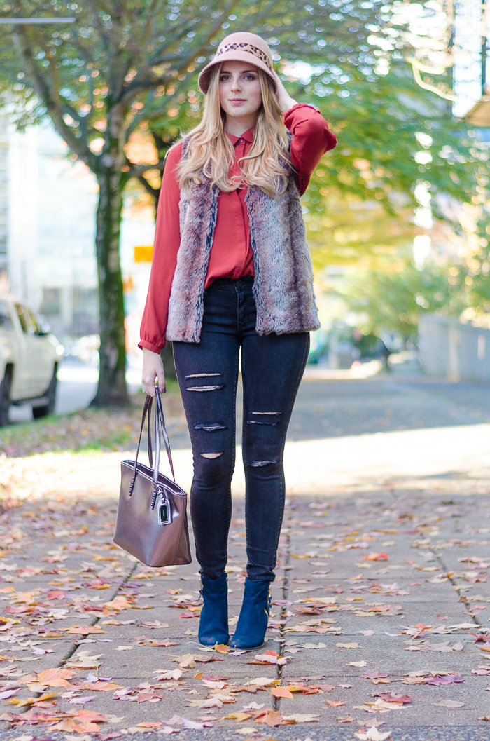 Fall Style in Forever 21 faux fur vest Orange blouse and ripped black American Eagle jeans