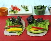 Arrange fresh veggies at one end.