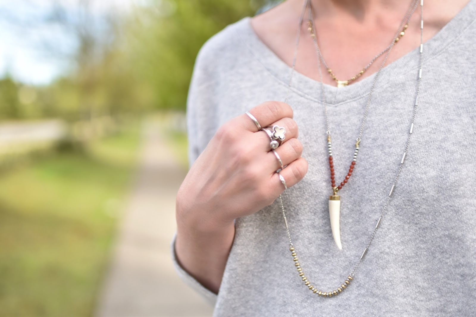 Monika Faulkner outfit inspiration - v-neck sweatshirt, layered necklaces and rings