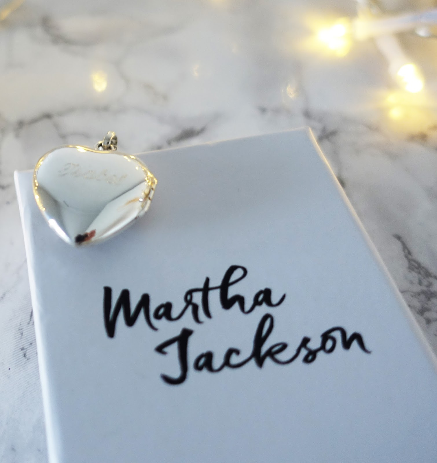 Image showing the engraving on the back of a silver vintage heart locket on a chain from Martha Jackson Jewellery