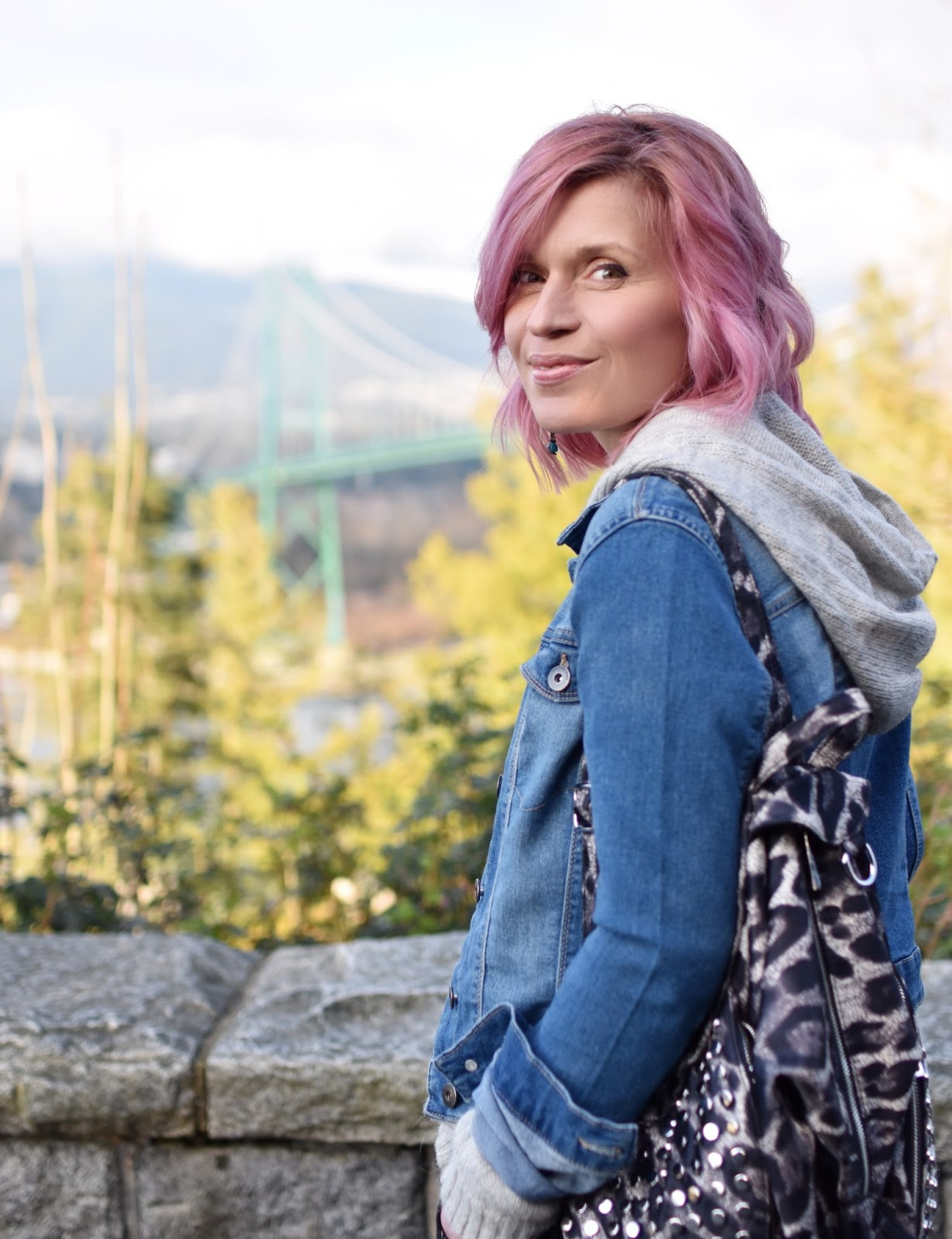 Monika Faulkner outfit inspiration - hoodie sweater, denim jacket, leopard-patterned backpack, pink hair