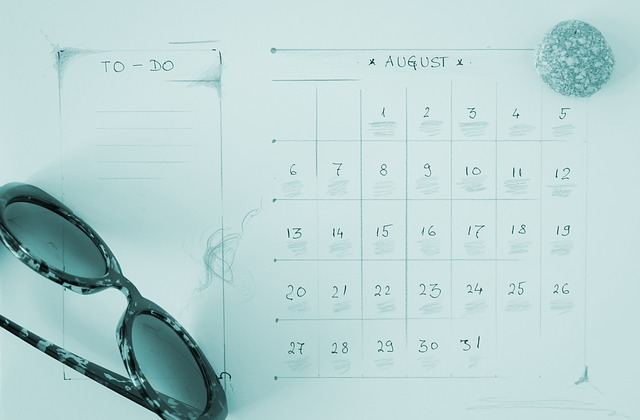 August hand-drawn calendar and sunglasses