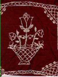 embroidery on burgundy velvet fabric