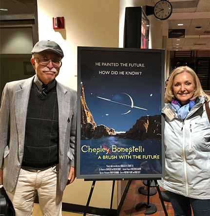 "Math Whiz, Dave and Resident Astronomer, Peggy, view iconic film poster based on Chesley Bonestell's  ""Saturn from Titan"" (1944) painting (Source: Palmia Observatory)"