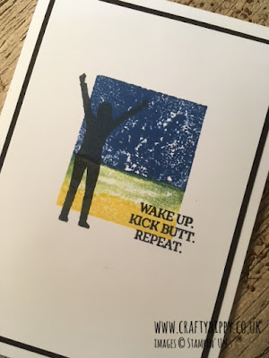 "This image shows a handmade card with the silhouette of a man with outstretched arms and the words ""wake up, kick butt, repeat"" and is made using the Enjoy Life stamp set from Stampin' Up!"